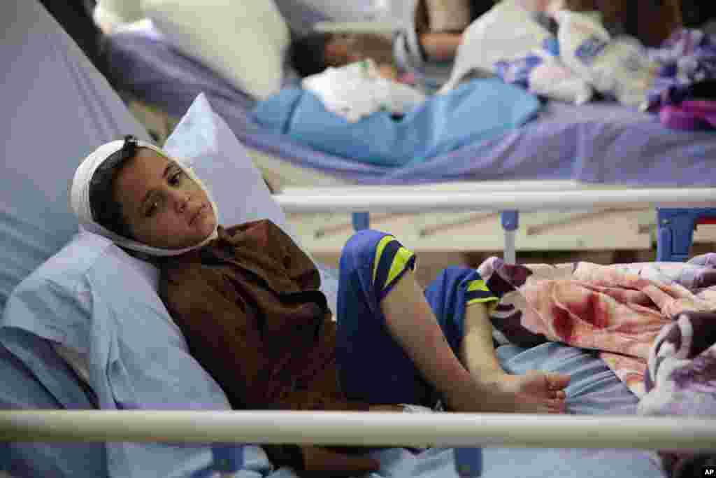 A child injured in a deadly Saudi-led coalition airstrike rests in a hospital in Saada, Yemen, Aug. 12, 2018.