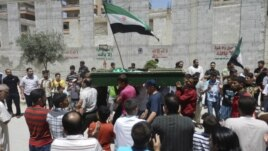 Anti-government protesters carry the body of Yaser Raqieh, whom protesters say was killed by forces loyal to Syria's President Bashar al-Assad, near Hama June 5, 2012.