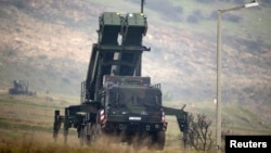 FILE - A Patriot missile installation is shown near the city of Kahramanmaras, Turkey, Feb. 23, 2013.
