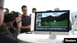 FILE - A new 27-inch iMac computer is seen following a presentation at Apple headquarters in Cupertino, California, Oct. 16, 2014.