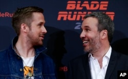 "Actor Ryan Gosling, left, and director Denis Villeneuve converse during a photo call to promote the film ""Blade Runner 2049"" in Barcelona, Spain, June 19, 2017."