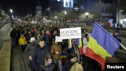 People march in protest against the ruling Social Democrats' plans to overhaul judicial legislation in Bucharest, Romania, Nov. 5, 2017.