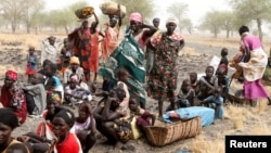 FILE - Women and children wait to be treated at a Medecins Sans Frontieres (MSF) support clinic in Thaker, Southern Unity, South Sudan, March 20, 2017.