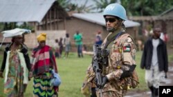 A Jordanian UN peacekeeper stands guard outside a base camp in the town of Bunagana, in Congo, May 16, 2012.