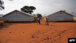 FILE - Refugees walk at the Nyumanzi transit center in Adjumani, Uganda, July 13, 2016.