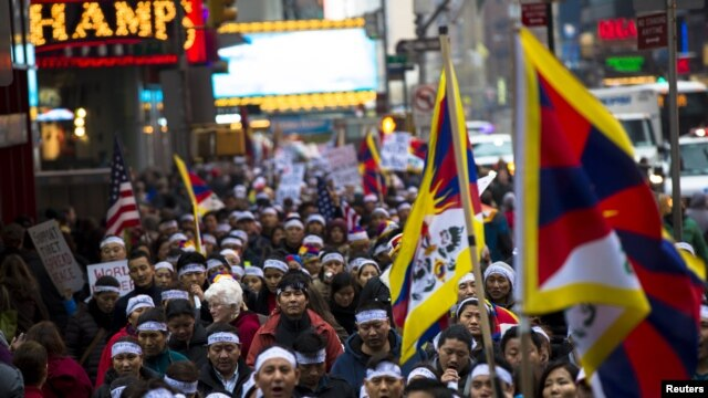 Protesters take part in a solidarity march from the Chinese Consulate to the United Nations (UN) Headquarters in support of Tibet in New York, December 10, 2012. The march also aims to brings to attention a string of self-immolations that have taken place