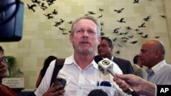FILE - South African Minister for Trade and Industry Rob Davies talks to the press.