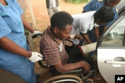 An injured Zimbabwean being taken to a hospital in Harare ...