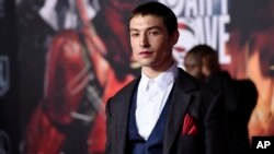 "Ezra Miller, a cast member in ""Justice League,"" poses at the premiere of the film at the Dolby Theatre, Nov. 13, 2017, in Los Angeles."