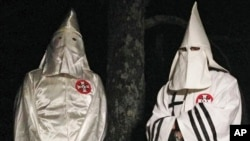 FILE - Two Ku Klux Klansmen take part in an interview near Pelham, North Carolina, Dec. 2, 2016. Glendon Crawford, sentenced to 30 years in prison, Dec. 19, 2016, for trying to build a bomb, was described as a self-professed member.