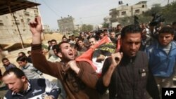 Palestinians carry the body of 12-year-old boy Ayoub Assaleya during his funeral in Jabalya in the northern Gaza Strip, March 11, 2012.