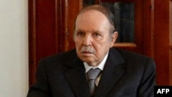A handout picture released by Algerian Press Service (APS) news agency on July 16, 2013 shows Algeria's President Abdelaziz Bouteflika attending a meeting with political and military figures following his arrival in Algeria at Boufarik military airport, s