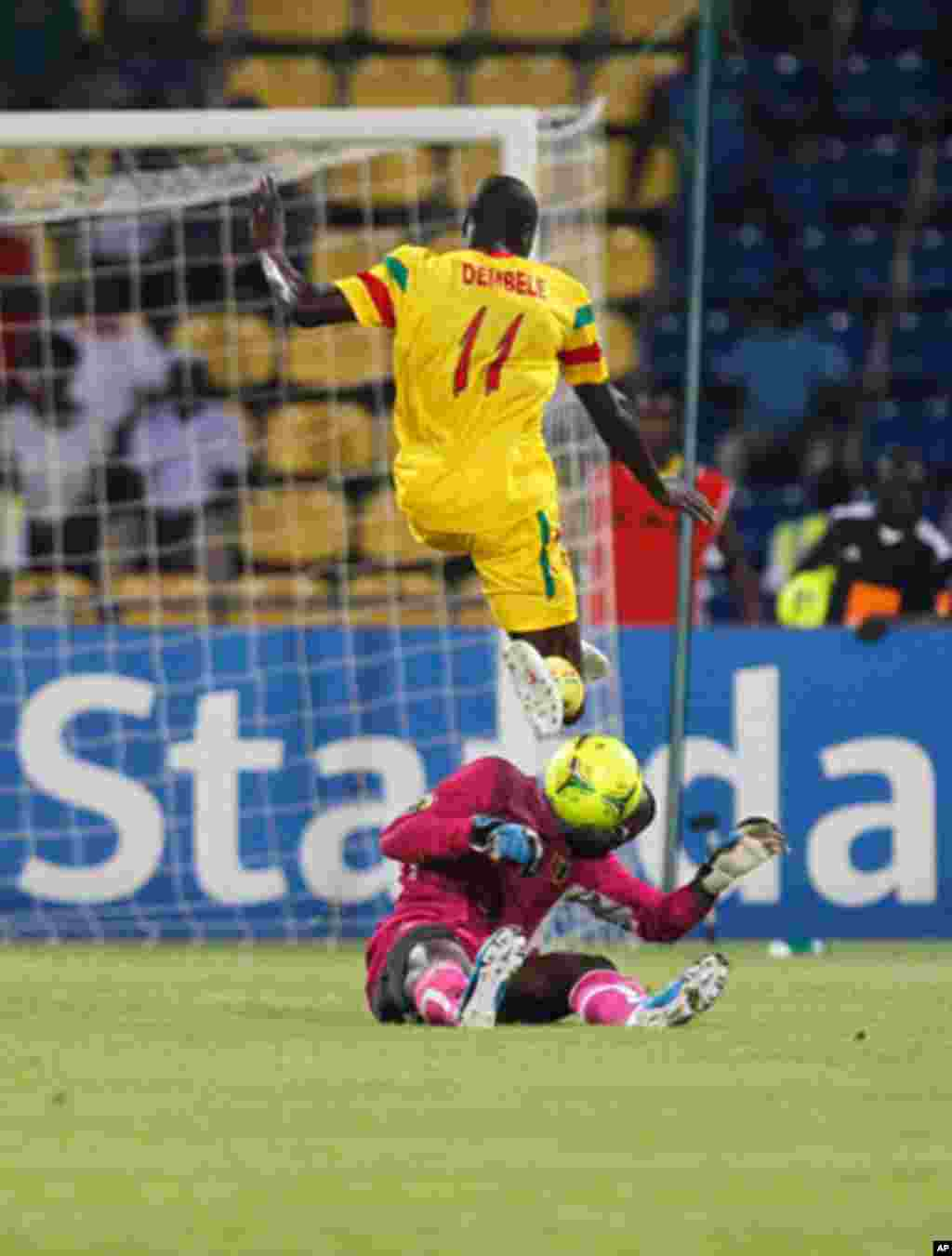 Guinea's goalkeeper Naby Yattara makes a save from Mali's Garra Dembele during their African Nations Cup Group D soccer match at Franceville Stadium