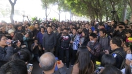Demonstrators gather along a street near the headquarters of Southern Weekly newspaper in Guangzhou, Guangdong province, January 7, 2013.