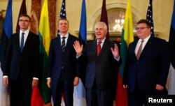Estonian Foreign Minister Sven Mikser, Latvian Foreign Minister Edgars Rinkevics, U.S. Secretary of State Rex Tillerson and Lithuanian Foreign Minister Linas Linkevicius, are seen before their meeting at the Department of State in Washington, March 28, 2017.