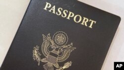 This May 25, 2021 photo shows a U.S. Passport cover in Washington. The Biden administration says American citizens holding recently expired U.S. passports will be allowed to return home from abroad on that document until the end of year. (AP Photo…