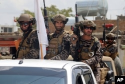 Taliban special forces fighters arrive at the Hamid Karzai International Airport after the U.S. military's withdrawal, in Kabul, Afghanistan, Aug. 31, 2021.
