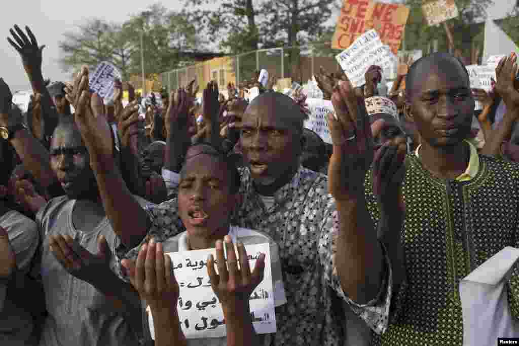 People pray during a rally against French satirical weekly Charlie Hebdo, which featured a cartoon of the Prophet Muhammad as the cover of its first edition since an attack by Islamist gunmen, in Bamako, Mali.