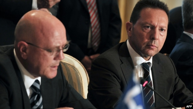 Greece's Finance Minister Yannis Stournaras, (R) listens to Trans Adriatic Pipeline's Managing Director Kjetil Tungland (L) after the signing of an host government agreement in Athens, June 26, 2013.