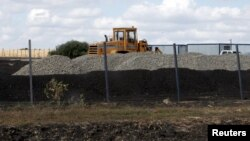 An excavator is seen at a construction site for Russia's new military base near the Russian-Ukrainian border in the village of Soloti, southeast of Belgorod, Russia, September 7, 2015.