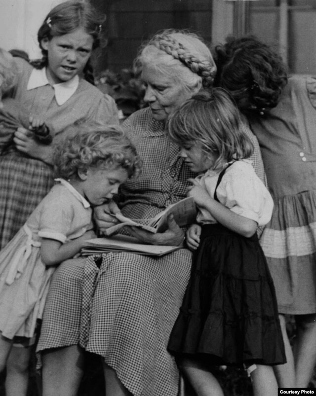 Dorothy Day with her grandchildren in 1958. (Marquette University Archives)