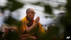 Dalai Lama prays during Ganden Ngachoe, the death anniversary of 14th Century Tibetan Saint-Scholar, Lama Tsongkhapa in New Delhi, Dec. 16, 2014.