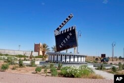 Movie-themed municipal art is seen on a traffic circle in Ouarzazate where dozens of foreign movies are filmed every year, Jan. 29, 2015.