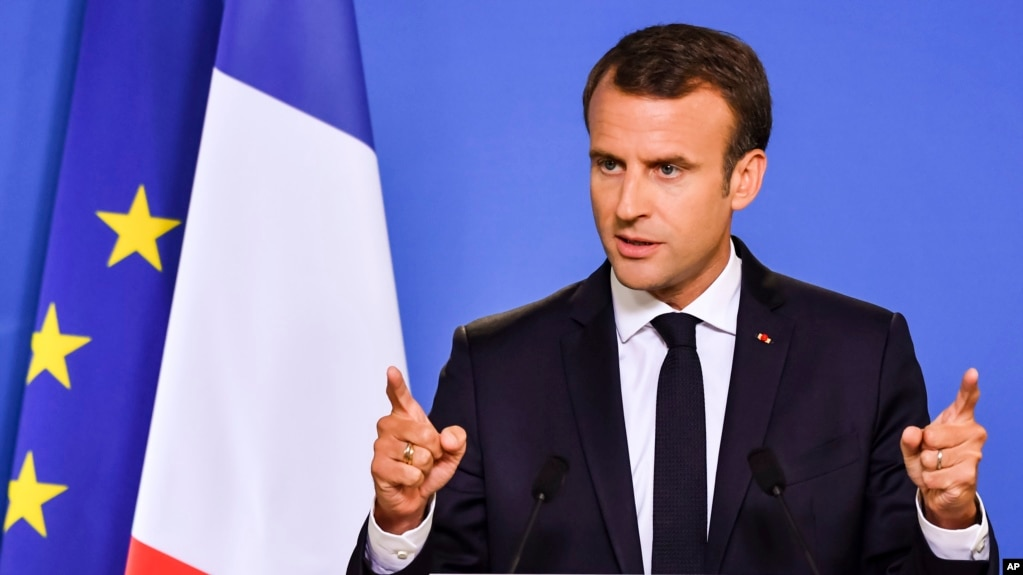 FILE - French President Emmanuel Macron speaks during a media conference at an EU summit in Brussels, June 29, 2018.
