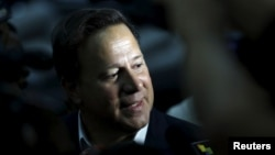 Panama's President Juan Carlos Varela talks to the media during a surprise visit at Atlapa Convention Center where the upcoming 7th Summit of the Americas will be held on April 10 and 11, in Panama City, April 2, 2015.