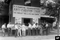 Evangelist T.T. Martin's books against the theory of evolution are sold at an outdoor stand in Dayton, Tenn., 1925, scene of the Scopes trial.