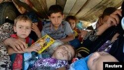 Para pengungsi etnis Yazidi tiba di provinsi Sulaimaniya (8/8). AS mulai menjatuhkan bantuan dari udara bagi para pengungsi di wilayah yang digempur kelompok militan.