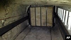 FILE - Undated image provided by US Department of Justice, shows elevator inside tunnel stretching from Mexico to San Diego.