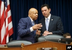 House Oversight and Government Reform Committee Chairman Rep. Jason Chaffetz, R-Utah, right, confers with the committee's ranking member Rep. Elijah Cummings, D-Md., on Capitol Hill in Washington, July 7, 2016, prior to hearing testimony from FBI Director James Comey.