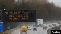 A motorway sign warning drivers about EU traffic restrictions is seen on the M56 motorway near Liverpool, Britain March 18, 2020.