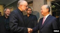 Директор Агентства по атомной энергии Ирана Али Акбар Салехи и глава МАГАТЭ Юкио Амано