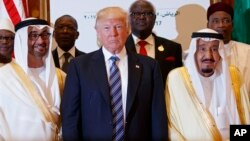 President Donald Trump poses for photos with King Salman, right, and others at the Arab Islamic American Summit, at the King Abdulaziz Conference Center, May 21, 2017, in Riyadh, Saudi Arabia.