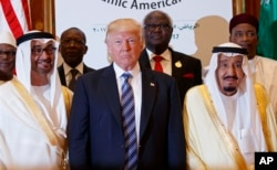 President Donald Trump poses for photos with King Salman and others at the Arab Islamic American Summit, at the King Abdulaziz Conference Center, May 21, 2017, in Riyadh, Saudi Arabia.