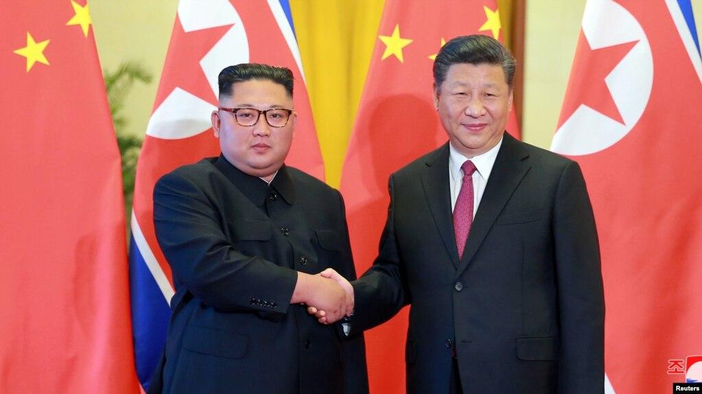 Ông Kim và ông Tập trong cuộc gặp hôm 20/6.