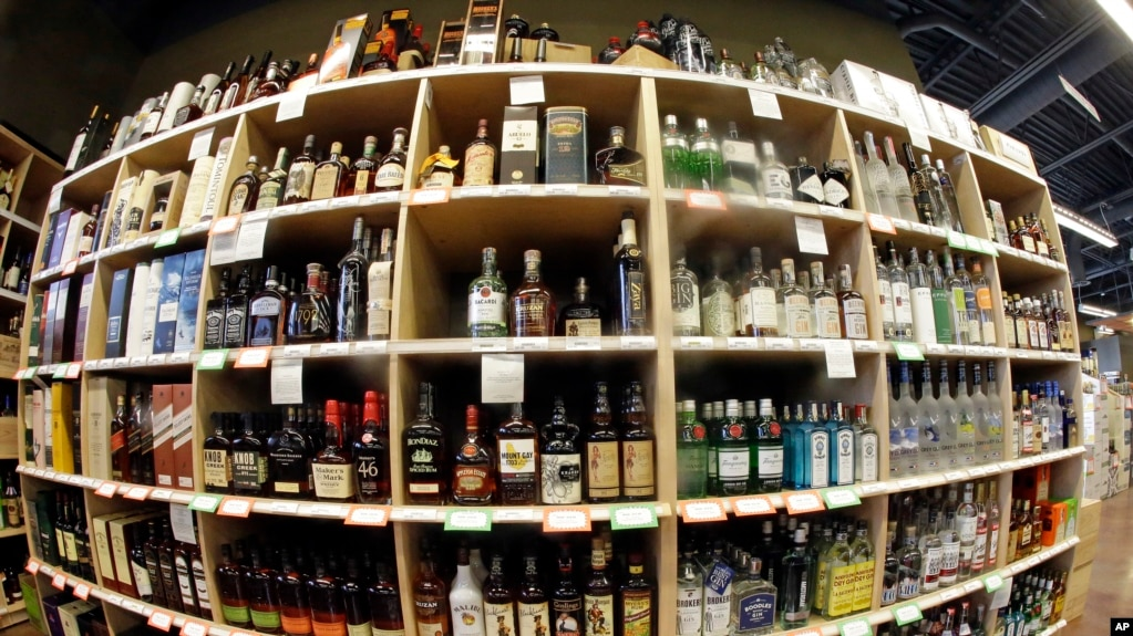 This June 16, 2016, file photo, taken with a fisheye lens, shows bottles of alcohol during a tour of a state liquor store, in Salt Lake City. (AP Photo/Rick Bowmer, File)