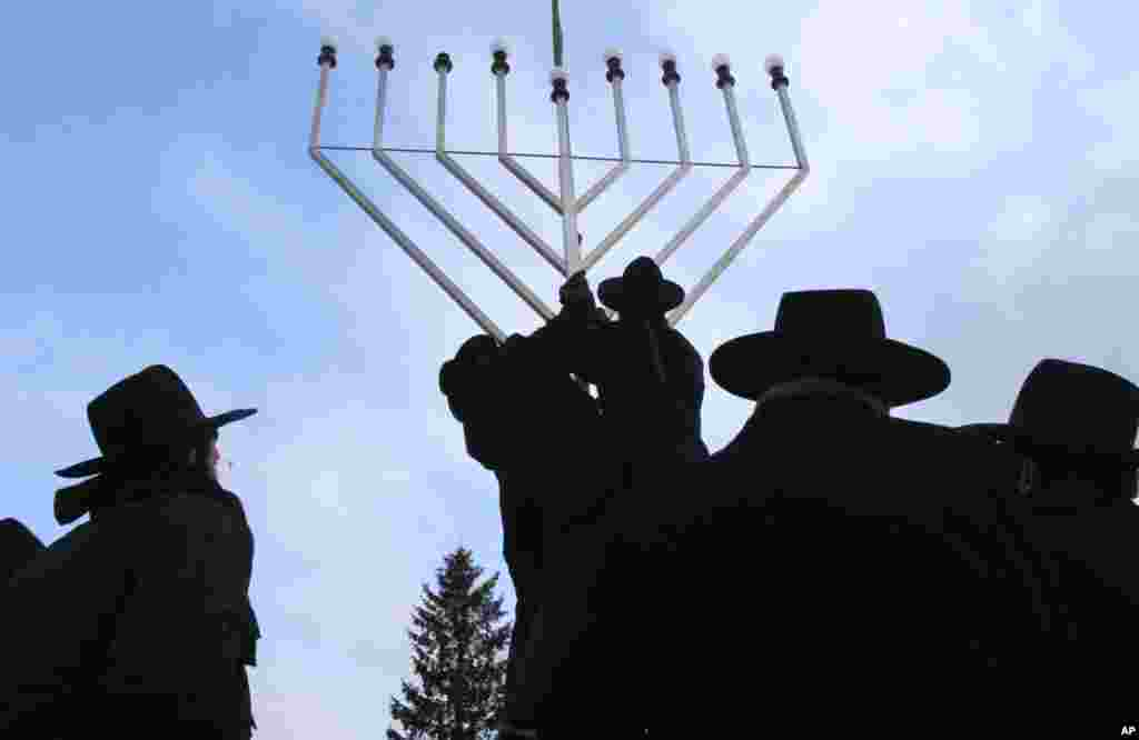 Rabbis inspect the setting-up of a large Menorah in front of the Brandenburg Gate in Berlin on December 1, ahead of a ceremony marking the Jewish celebration of Hanukkah. (Tobias Schwarz/Reuters)