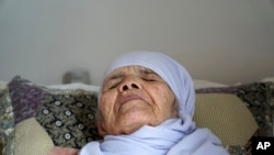 Afghan refugee Bibihal Uzbeki, 106 years old, lies in bed in Hova, Sweden, Sept. 3, 2017.