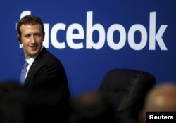 FILE - Facebook CEO Mark Zuckerberg on stage during a town hall at Facebook's headquarters in Menlo Park, California, Feb. 27, 2015.