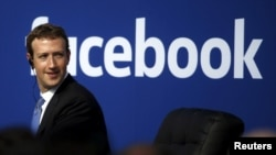 FILE - Facebook CEO Mark Zuckerberg on stage during a town hall at Facebook's headquarters in Menlo Park, California.