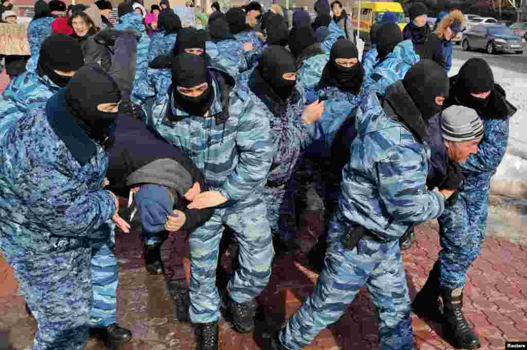 Kazakh law enforcement officers detain protesters during a rally held by opposition supporters, after anti-government activist has died of heart problems in a police detention center earlier this week, in Nur-Sultan, Kazakhstan.