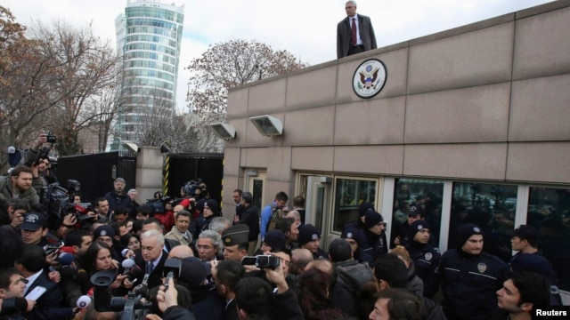 U.S. Ambassador to Turkey Francis Ricciardone (L, with white hair) speaks to media outside of the U.S. Embassy in Ankara, February 1, 2013.