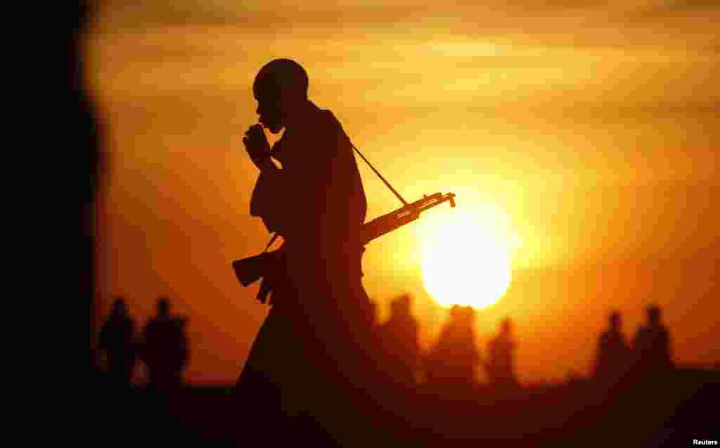 Rebel fighters walk in a rebel-controlled territory in Upper Nile State, South Sudan.