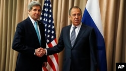 U.S. Secretary of State John Kerry, left, shakes hands with Russian Foreign Minister Sergey Lavrov at a bilateral meeting to discuss the ongoing situation in Ukraine, April 17, 2014.