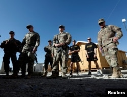 FILE - U.S. troops listen to a security briefing before leave their base in Logar province, Afghanistan, Aug. 5, 2018.