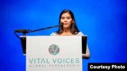 Tep Vanny, 31, a prominent Cambodian housing rights activist, talks to over 2,500 people after receiving the Vital Voices Global Leadership Award 2013 (Leadership in Public Life Award) at the Kennedy Center in Washington, DC, April 2, 2013. (Courtesy of Vital Voices/Kate Hauschka)