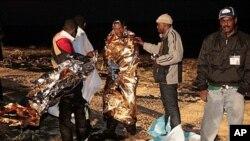 移民獲意大利救援人員救起。